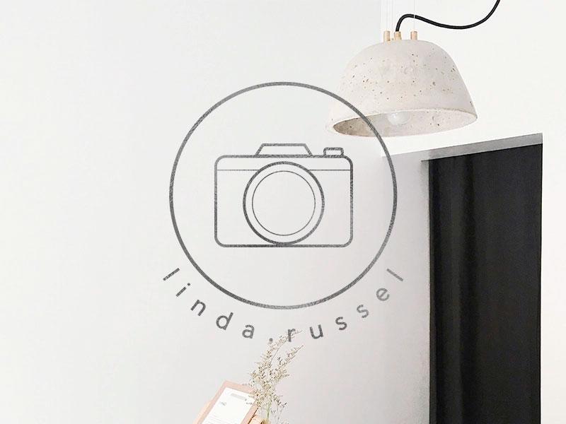 Logotipo de fotografía minimalista.